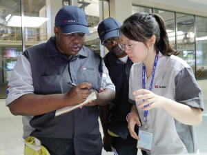 Trainees work with interpreters while in China