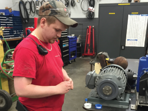 Apprentice Dylan Lowe working in the machine shop